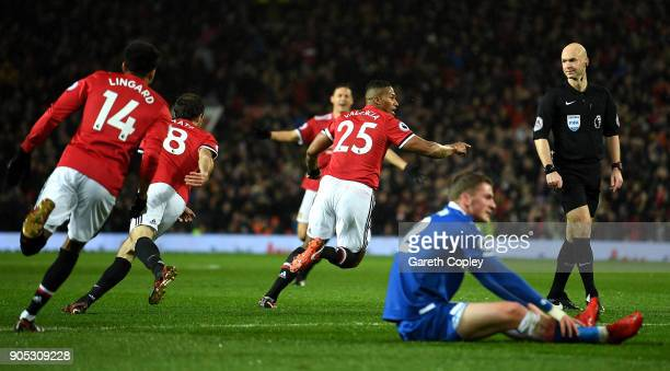 Antonio Valencia of Manchester United celebrates scoring his side's first goal during the Premier League match between Manchester United and Stoke...
