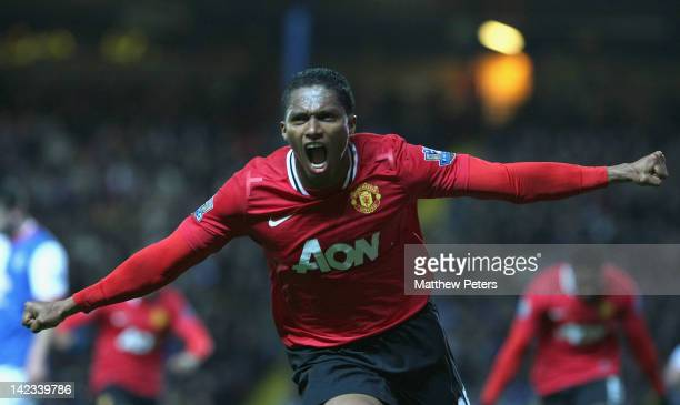 Antonio Valencia of Manchester United celebrates scoring their first goal during the Barclays Premier League match between Blackburn Rovers and...