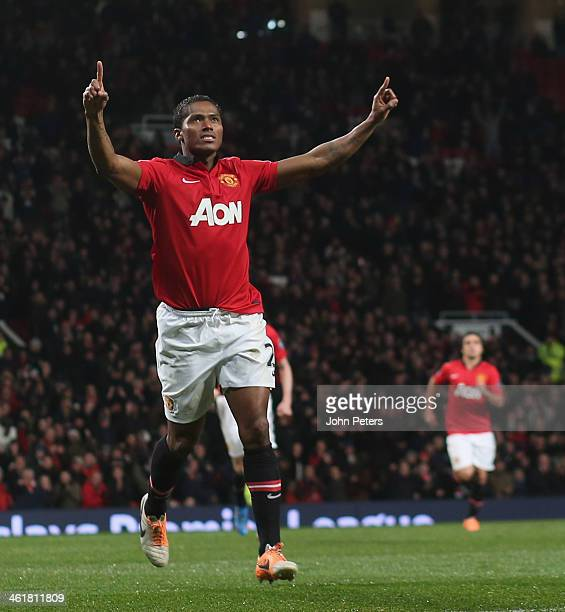 Antonio Valencia of Manchester United celebrates scoring their first goal during the Barclays Premier League match between Manchester United and...