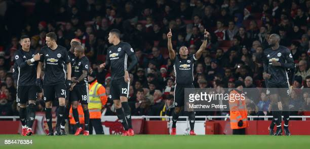 Antonio Valencia of Manchester United celebrates scoring their first goal during the Premier League match between Arsenal and Manchester United at...