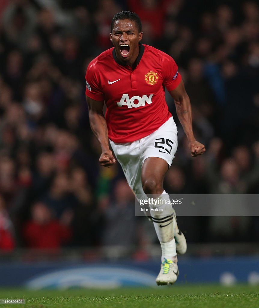 Antonio Valencia of Manchester United celebrates scoring their fourth goal during the UEFA Champions League Group A match between Manchester United and Bayer Leverkusen at Old Trafford on September 17, 2013 in Manchester, England.