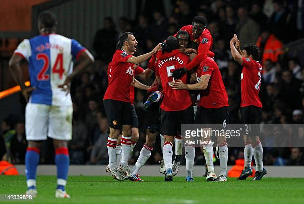 Antonio Valencia of Manchester United celebrates with his team mates after scoring the opening goal during the Barclays Premier League match between...