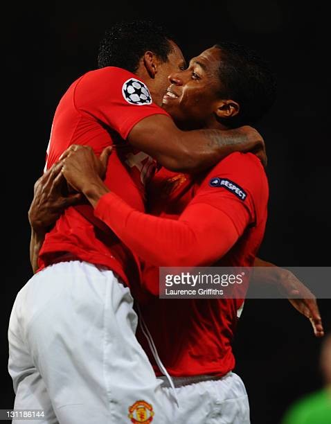 Antonio Valencia of Manchester United celebrates with Luis Nani as he scores their first goal during the UEFA Champions League Group C match between...