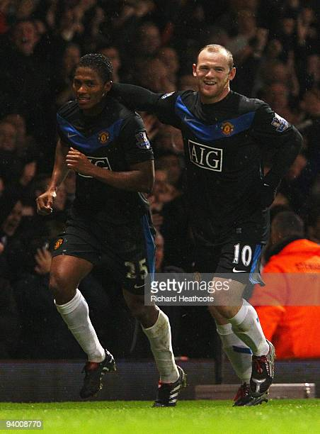 Antonio Valencia of Manchester United celebrates with Wayne Rooney as he scores their third goal during the Barclays Premier League match between...