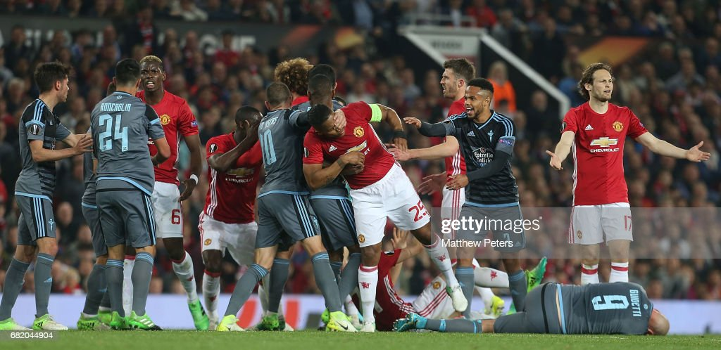 Antonio Valencia of Manchester United clashes with Iago Aspas of Celta Vigo while Paul Pogba clashes with Facundo Roncaglia during the UEFA Europa League, semi final second leg match, between Manchester United and Celta Vigo at Old Trafford on May 11, 2017 in Manchester, United Kingdom.