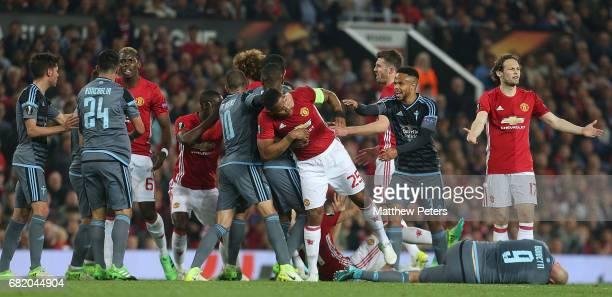 Antonio Valencia of Manchester United clashes with Iago Aspas of Celta Vigo while Paul Pogba clashes with Facundo Roncaglia during the UEFA Europa...