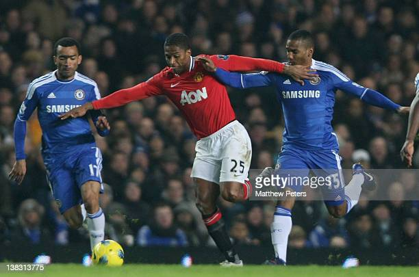 Antonio Valencia of Manchester United clashes with Jose Bosingwa and Florent Malouda of Chelsea during the Barclays Premier League match between...