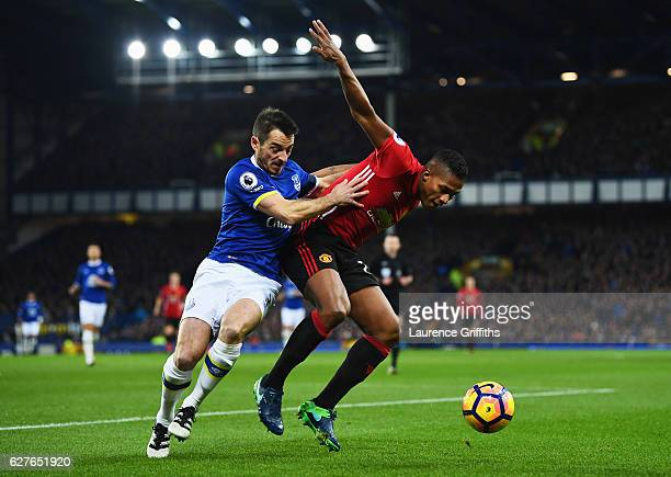 Antonio Valencia of Manchester United holds off Leighton Baines of Everton during the Premier League match between Everton and Manchester United at...