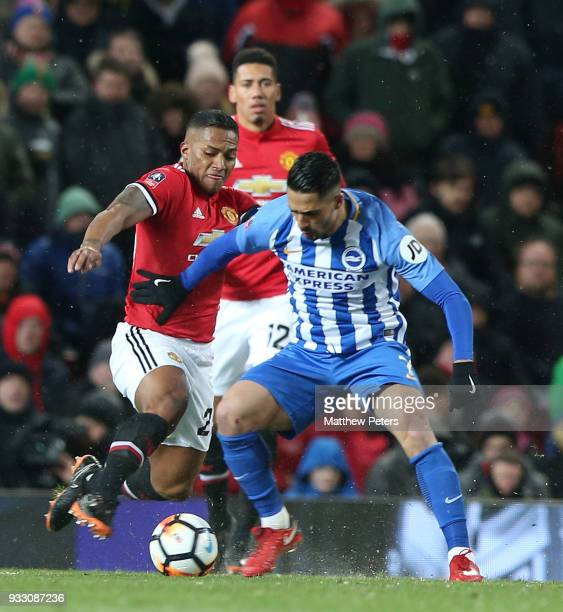 Antonio Valencia of Manchester United in action with Beram Kayal of Brighton Hove Albion during the Emirates FA Cup Quarter Final match between...