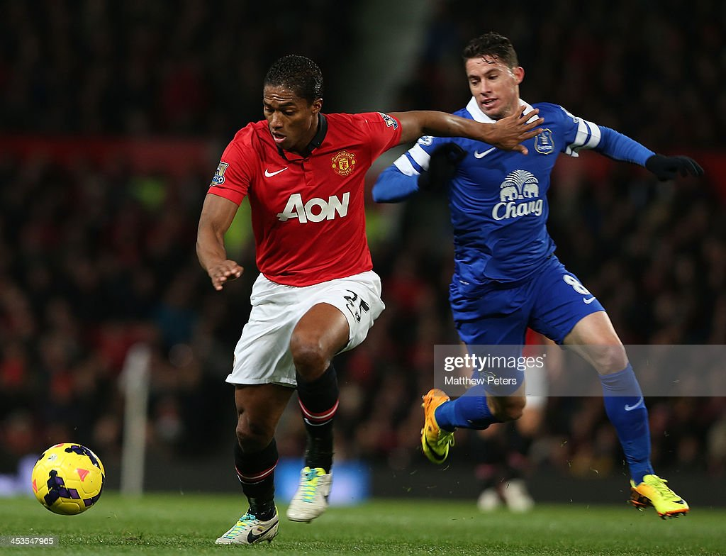 Antonio Valencia of Manchester United in action with Bryan Oviedo of Everton during the Barclays Premier League match between Manchester United and Everton at Old Trafford on December 4, 2013 in Manchester, England.
