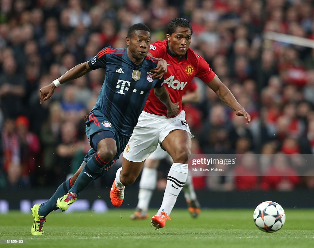 Antonio Valencia of Manchester United in action with David Alaba of Bayern Munich during the UEFA Champions League quarter-final first leg match between Manchester United and Bayern Munich at Old Trafford on April 1, 2014 in Manchester, England.