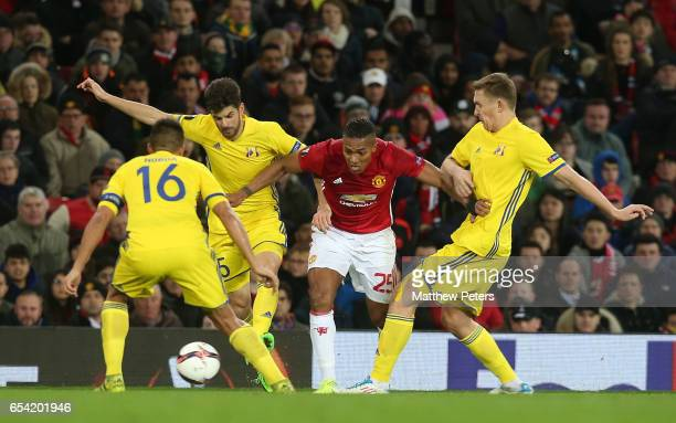 Antonio Valencia of Manchester United in action with Denis Terentyev and Aleksandr Bukharov of FK Rostov during the UEFA Europa League Round of 16...