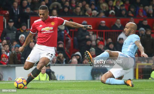 Antonio Valencia of Manchester United in action with Fabian Delph of Manchester City during the Premier League match between Manchester United and...