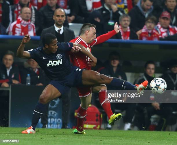 Antonio Valencia of Manchester United in action with Franck Ribery of Bayern Munich during the UEFA Champions League quarterfinal second leg match...
