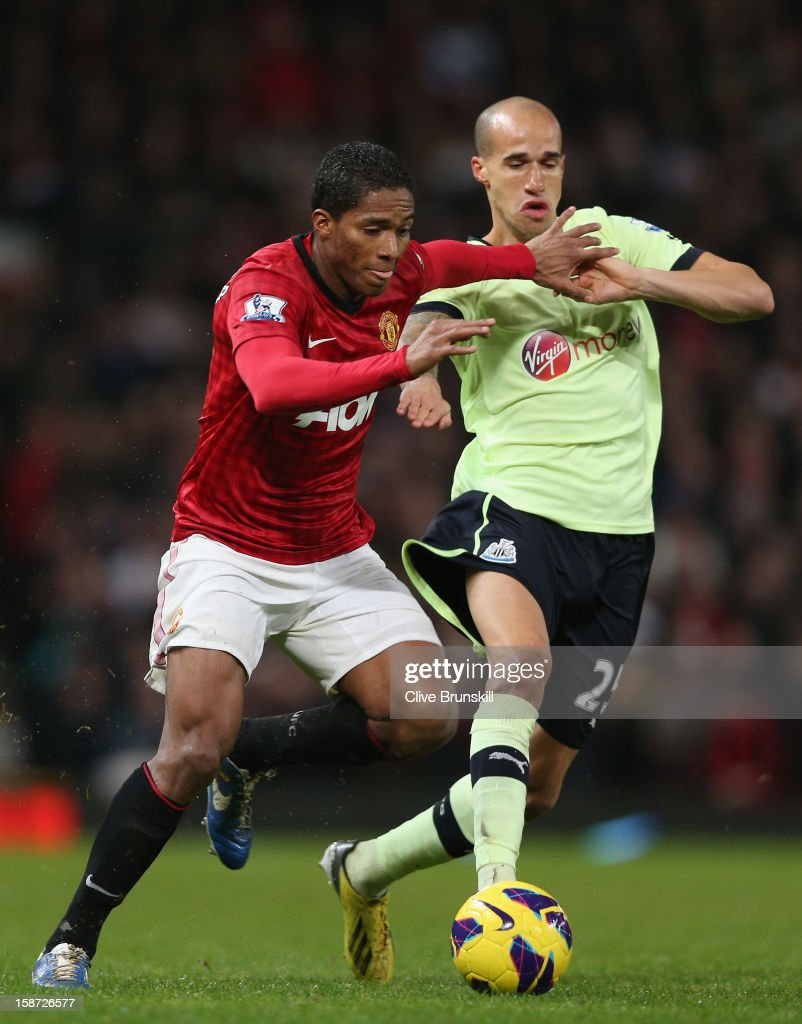 Antonio Valencia of Manchester United in action with Gabriel Obertan of Newcastle United during the Barclays Premier League match between Manchester United and Newcastle United at Old Trafford December 26, 2012 in Manchester, England.
