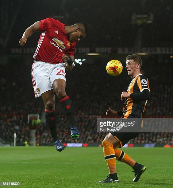 Antonio Valencia of Manchester United in action with Josh Tymon of Hull City during the EFL Cup SemiFInal first leg match between Manchester United...