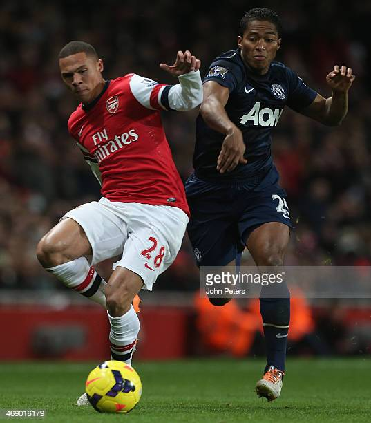 Antonio Valencia of Manchester United in action with Kieran Gibbs of Arsenal during the Barclays Premier League match between Arsenal and Manchester...