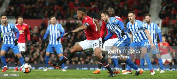 Antonio Valencia of Manchester United in action with Markus Suttner of Brighton Hove Albion during the Emirates FA Cup Quarter Final match between...