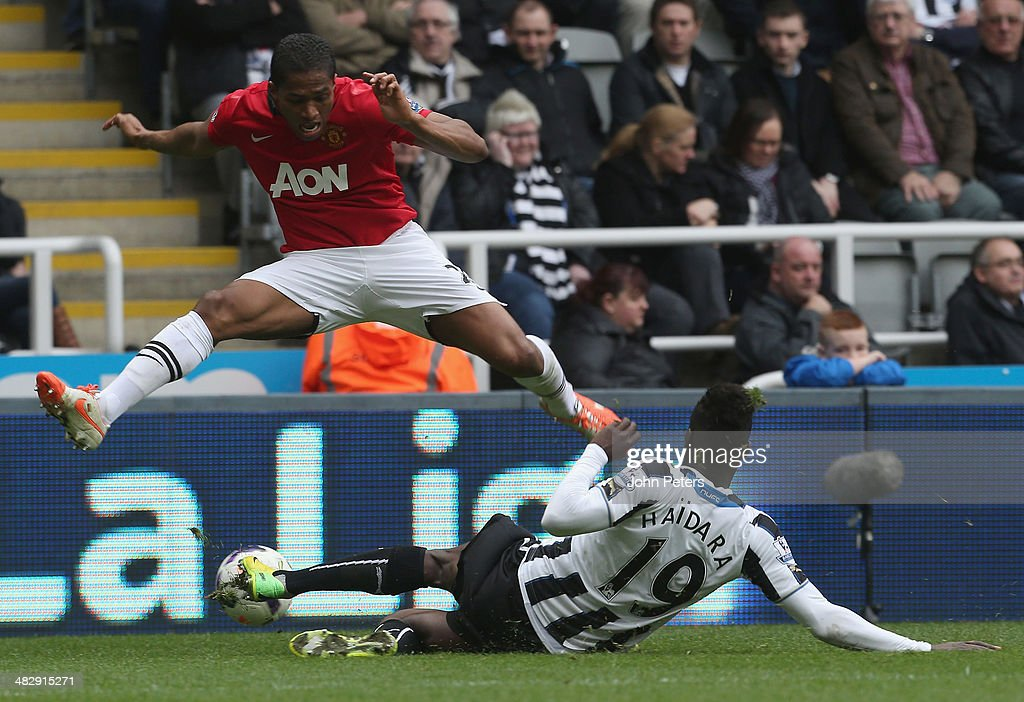 Antonio Valencia of Manchester United in action with Massadio Haidara of Newcastle United during the Barclays Premier League match between Newcastle United and Manchester United at St James' Park on April 5, 2014 in Newcastle upon Tyne, England.