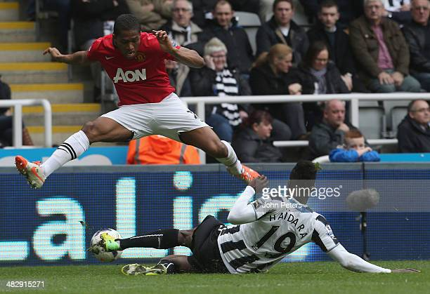 Antonio Valencia of Manchester United in action with Massadio Haidara of Newcastle United during the Barclays Premier League match between Newcastle...