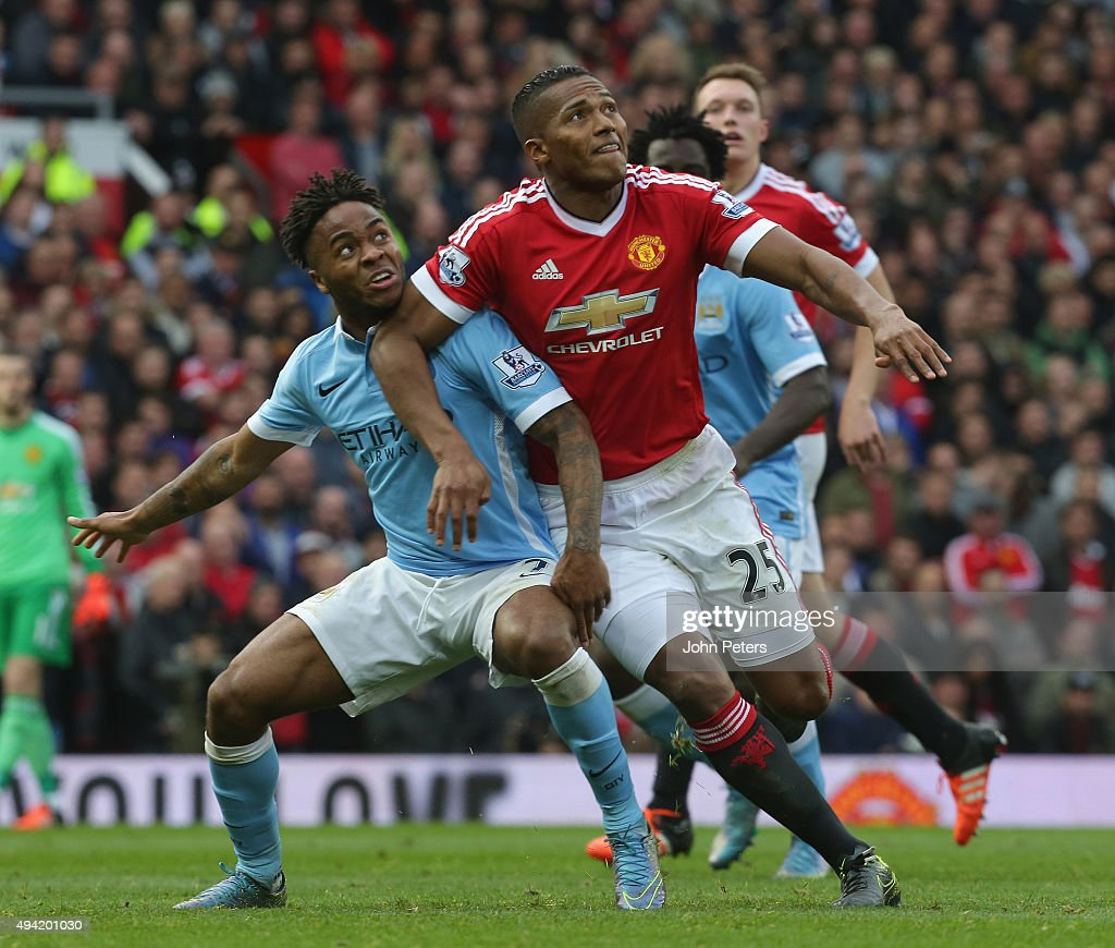 Antonio Valencia of Manchester United in action with Raheem Sterling of Manchester City during the Barclays Premier League match between Manchester United and Manchester City at Old Trafford on October 25, 2015 in Manchester, England.