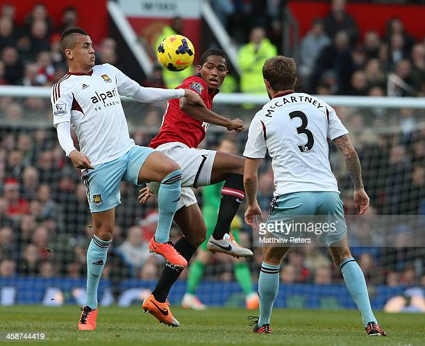 Antonio Valencia of Manchester United in action with Ravel Morrison of West Ham United during the Barclays Premier League match between Manchester...