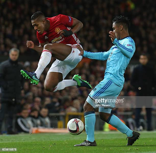 Antonio Valencia of Manchester United in action with Renato Tapia of Feyenoord during the UEFA Europa League match between Manchester United FC and...