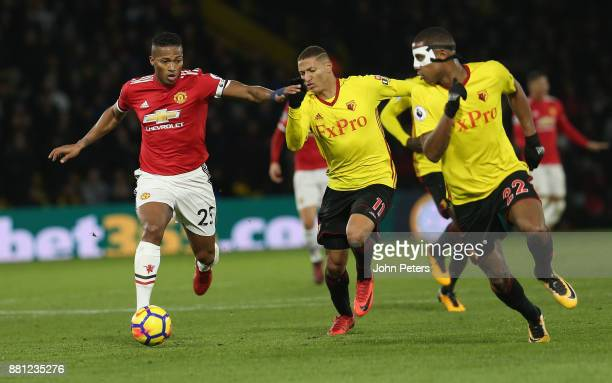 Antonio Valencia of Manchester United in action with Richarlison and Marvin Zeegelaar of Watford during the Premier League match between Watford and...