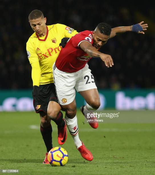 Antonio Valencia of Manchester United in action with Richarlison of Watford during the Premier League match between Watford and Manchester United at...