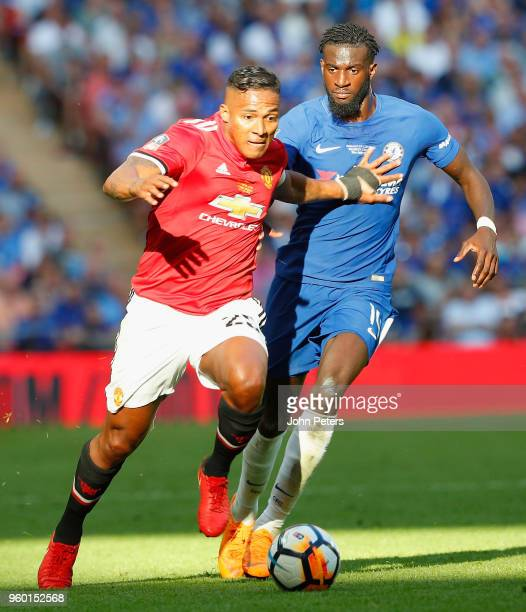 Antonio Valencia of Manchester United in action with Tiemoue Bakayoko of Chelsea during the Emirates FA Cup Final match between Manchester United and...