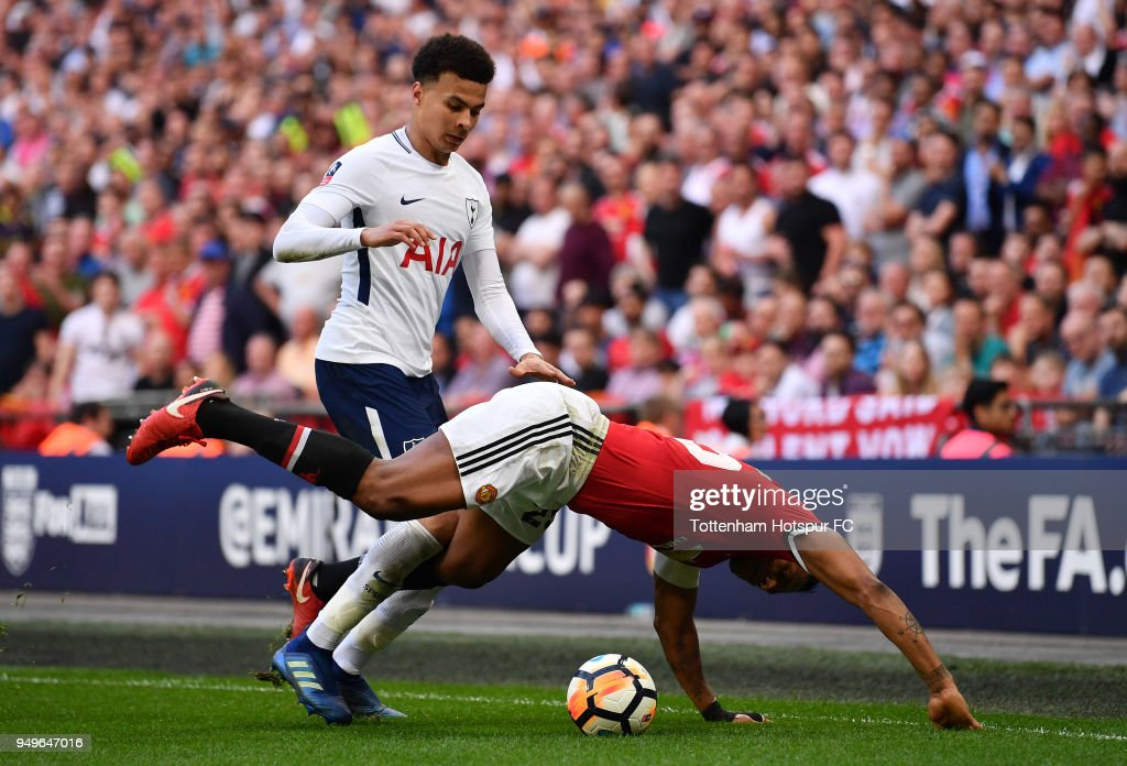 Antonio Valencia of Manchester United is challenged by Dele Alli of Tottenham Hotspur during The Emirates FA Cup Semi Final match between Manchester United and Tottenham Hotspur at Wembley Stadium on April 21, 2018 in London, England.