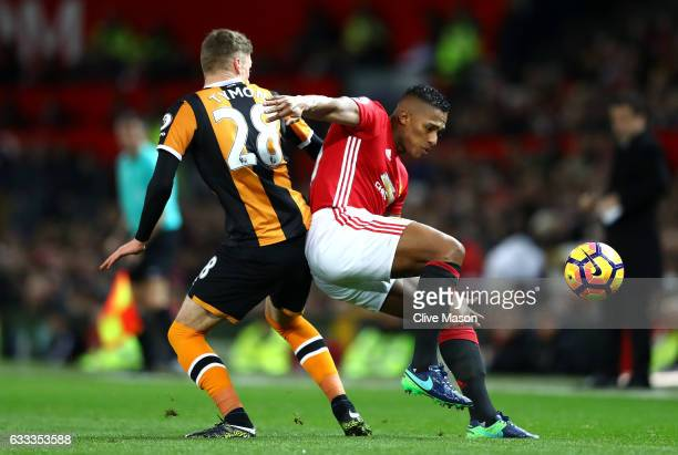 Antonio Valencia of Manchester United is challenged by Josh Tymon of Hull City during the Premier League match between Manchester United and Hull...
