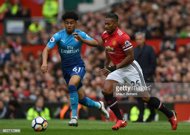 Antonio Valencia of Manchester United is challenged by Reiss Nelson of Arsenal during the Premier League match between Manchester United and Arsenal...