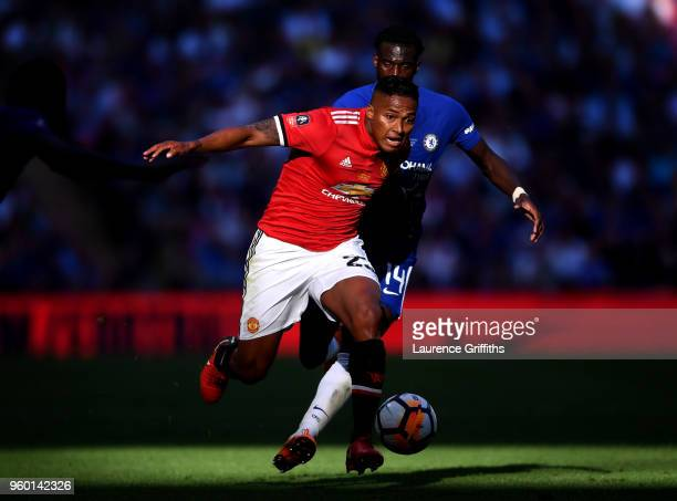 Antonio Valencia of Manchester United is challenged by Tiemoue Bakayoko of Chelsea during The Emirates FA Cup Final between Chelsea and Manchester...