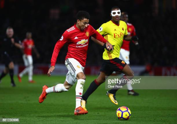 Antonio Valencia of Manchester United is chased by Marvin Romeo Kwasie Zeegelaar of Watford during the Premier League match between Watford and...