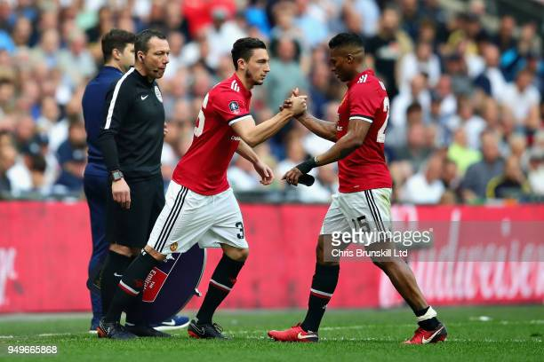 Antonio Valencia of Manchester United is replaced as a substitute by teammate Matteo Darmian during The Emirates FA Cup Semi Final match between...