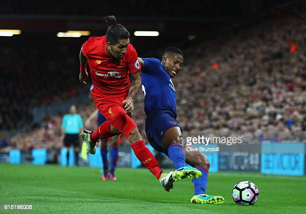 Antonio Valencia of Manchester United is tackled by Roberto Firmino of Liverpool during the Premier League match between Liverpool and Manchester...