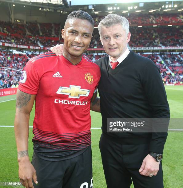 Antonio Valencia of Manchester United poses with Ole Gunnar Solskjaer after the Premier League match between Manchester United and Cardiff City at...