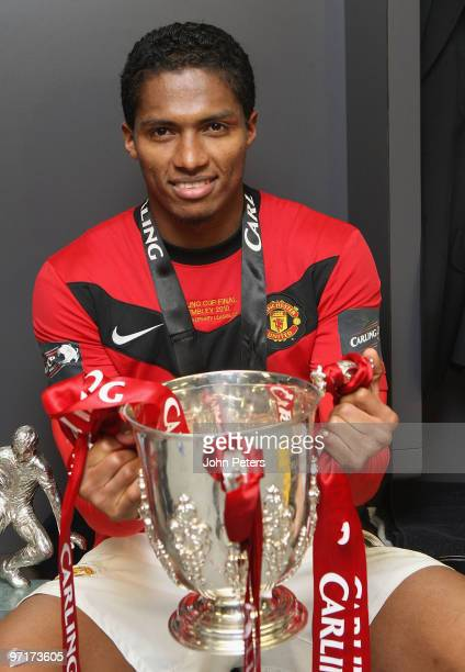 Antonio Valencia of Manchester United poses with the Carling Cup trophy in the dressing room after the Carling Cup Final match between Aston Villa...
