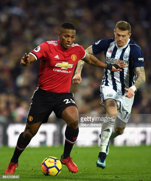 Antonio Valencia of Manchester United runs with the ball under pressure from James McClean of West Bromwich Albion during the Premier League match...