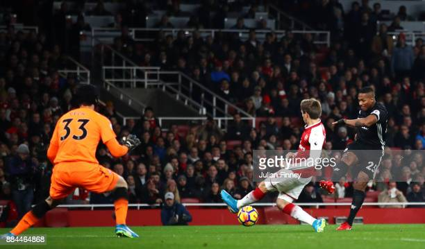 Antonio Valencia of Manchester United scores his sides first goal past Petr Cech of Arsenal during the Premier League match between Arsenal and...