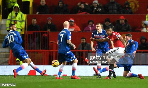 Antonio Valencia of Manchester United scores his sides first goal during the Premier League match between Manchester United and Stoke City at Old...