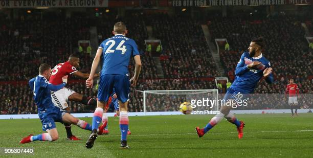 Antonio Valencia of Manchester United scores their first goal during the Premier League match between Manchester United and Stoke City at Old...
