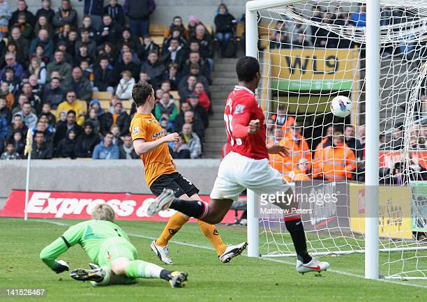 Antonio Valencia of Manchester United scores their second goal during the Barclays Premier League match between Wolverhampton Wanderers and...