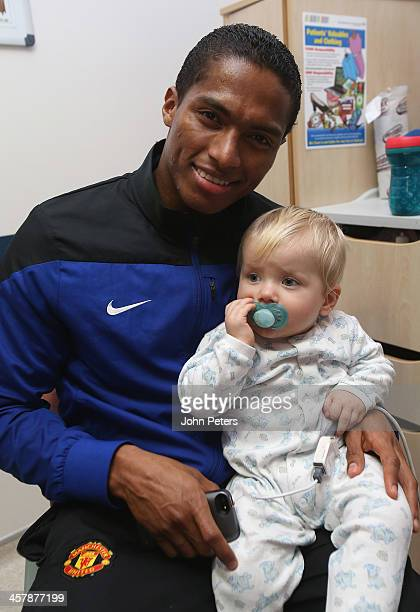 Antonio Valencia of Manchester United visits Joseph Hewitt 4 months from Burnage in Royal Manchester Children's Hospital as part of the club's annual...