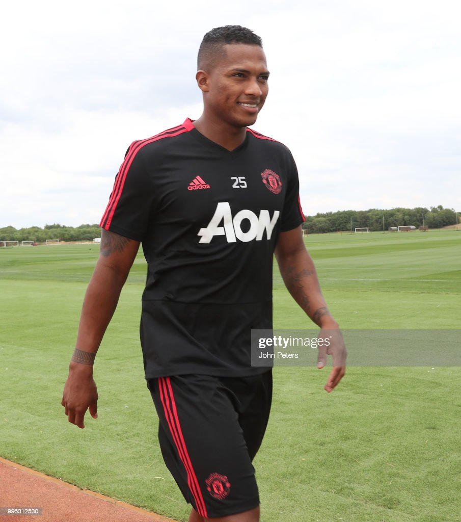 Antonio Valencia of Manchester United walks out ahead of a first team training session at Aon Training Complex on July 11, 2018 in Manchester, England.