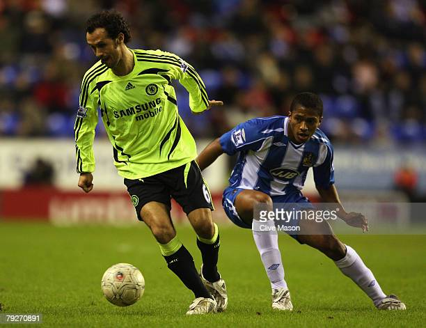 Antonio Valencia of Wigan Athletic is foiled by Ricardo Carvalho of Chelsea during the FA Cup sponsored by EON 4th Round match between Wigan Athletic...