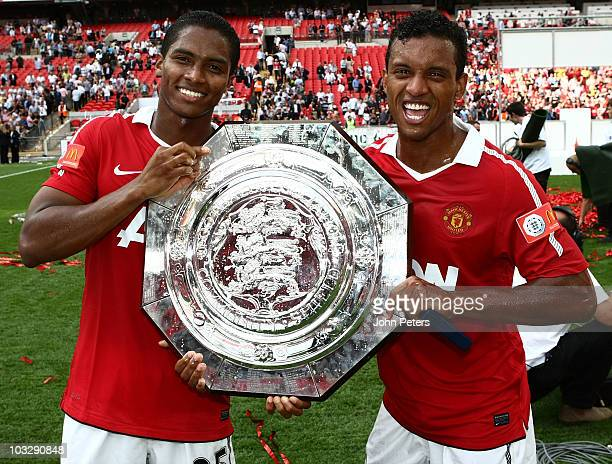 Antonio Valenica and Nani pose with the Community Shield after the FA Community Shield match between Chelsea and Manchester United at Wembley Stadium...