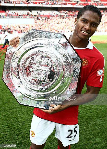 Antonio Valenica of Manchester United poses with the Community Shield after the FA Community Shield match between Chelsea and Manchester United at...