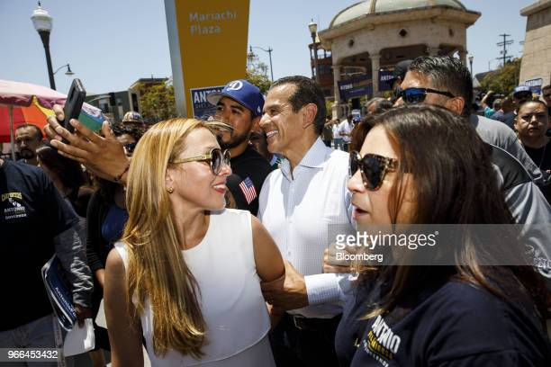 Antonio Villaraigosa Democratic candidate for governor of California center and his wife Patricia Govea front left stand for photographs with...